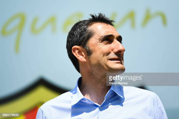 New FC Barcelona head coach Ernesto Valverde poses for the media outside the FC Barcelona headquarters at Camp Nou on May 31 2017 in Barcelona Spain