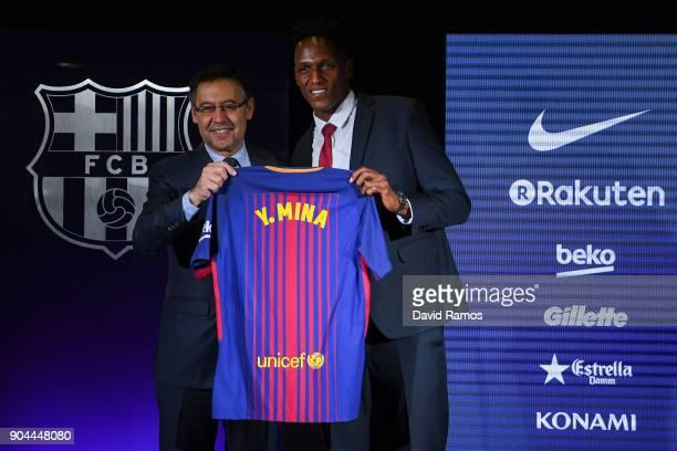 New FC Barcelona player Yerry Mina and Josep Maria Bartomeu President of FC Barcelona pose his shirt at Nou Camp on January 13 2018 in Barcelona...