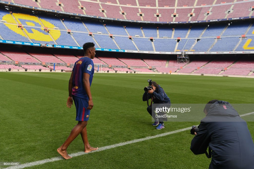 New FC Barcelona player Yerry Mina walks on the pitch without boots as he is unveiling at Nou Camp on January 13, 2018 in Barcelona, Spain. The Colombian player signed from Palmerias, has agreed a deal with the Catalan club until 2022 season.