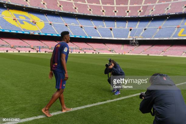 New FC Barcelona player Yerry Mina walks on the pitch without boots as he is unveiling at Nou Camp on January 13 2018 in Barcelona Spain The...