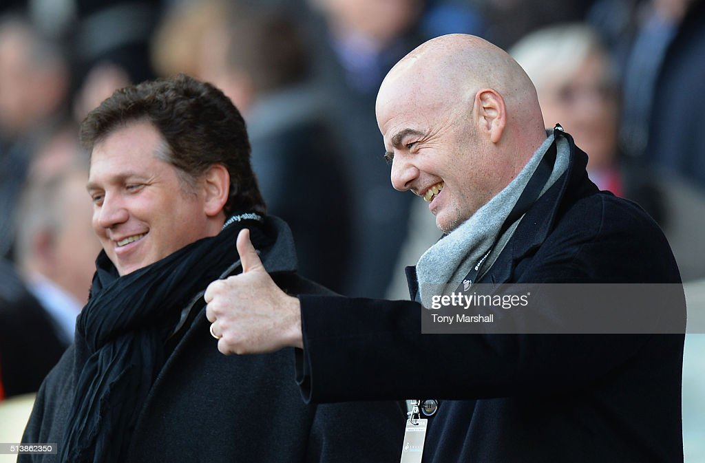 New FIFA President Gianni Infantino (R) thumbs up prior to the Barclays Premier League match between Swansea City and Norwich City at Liberty Stadium on March 5, 2016 in Swansea, Wales.