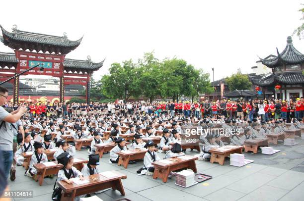 New firstgraders attend a first writing ceremony at the Confucius Temple on August 31 2017 in Nanjing Jiangsu Province of China Firstgraders write...
