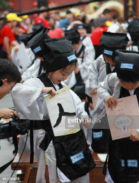 New firstgraders put away their calligraphy during a first writing ceremony at the Confucius Temple on August 31 2017 in Nanjing Jiangsu Province of...