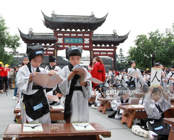 New firstgraders read new books during a first writing ceremony at the Confucius Temple on August 31 2017 in Nanjing Jiangsu Province of China...