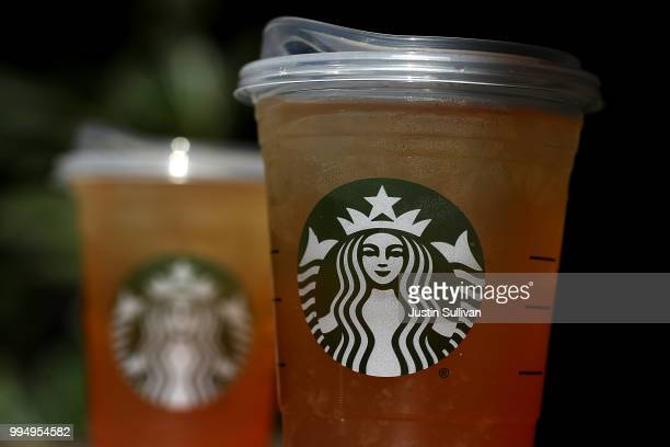 A new flat plastic lid that does not need a straw is shown on a cup of Starbucks iced tea on July 9 2018 in Sausalito California Starbucks announced...
