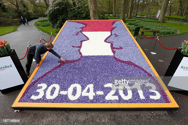 New flower decoration illustrating Queen Beatrix and Prince Willem Alexander is shown to the public at Keukenhof flower show on April 29, 2013 in...