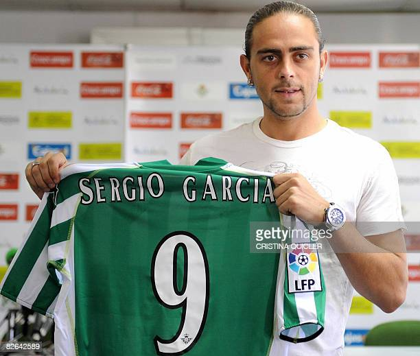 New football forward Sergio Garcia poses on September 3 2008 during his presentation with a jersey of the Spanish first division Real Betis team at...