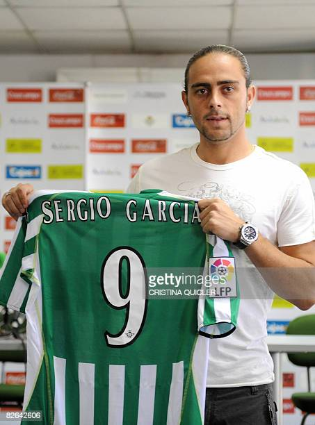 New football forward Sergio Garcia poses with his jersey on September 3 2008 during his presentation as a recruit of the Spanish first division Real...