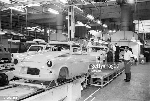 New Ford Anglia cars coming off the production line at the new Ford paint trim and assembly plant in Dagenham Essex 27th October 1959