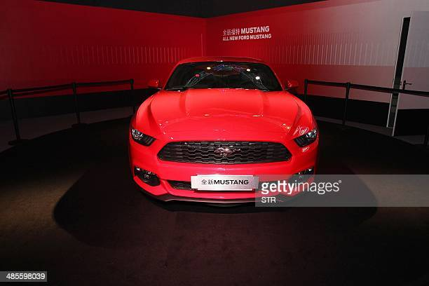 A new Ford Mustang car on display at the 50 years celebration ceremony of Ford Mustang in Beijing on April 19 ahead of the 'Auto China 2014' Beijing...