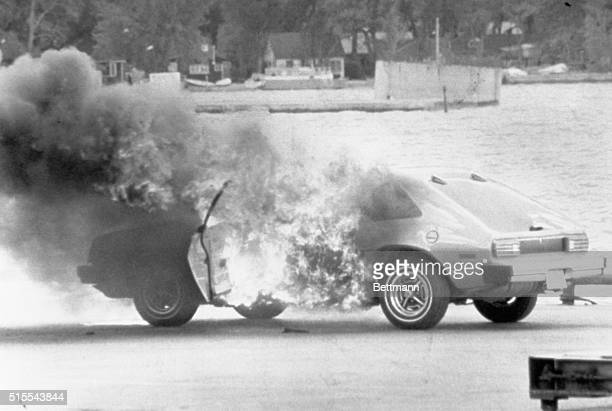 A new Ford Pinto lent by Ford Motor Company to a local newspaper for consumer testing burns as a photographer was photographing it for an automobile...