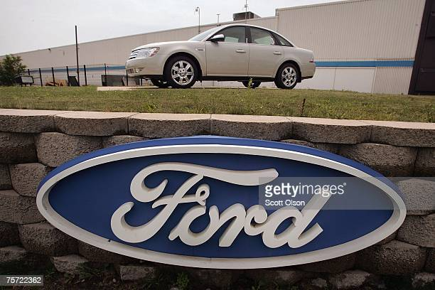A new Ford Taurus is displayed in front of the manufacturer's assembly plant July 26 2007 in Chicago Illinois The troubled automaker today posted its...