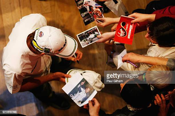 New Formula One World Champion Jenson Button of Great Britain and Brawn GP signs autographs at a question and answer session following a Virgin...