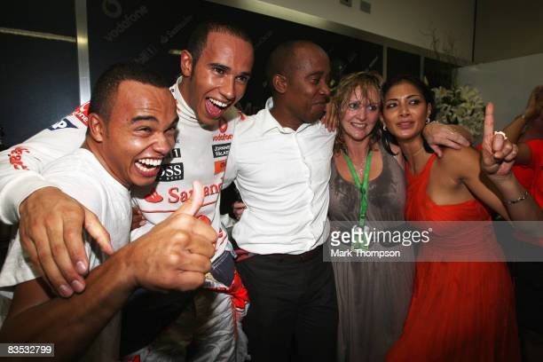 New Formula One World Champion Lewis Hamilton of Great Britain and McLaren Mercedes celebrates with his halfbrother Nick Hamilton his father Anthony...