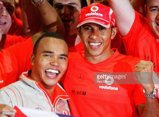 New Formula One World Champion Lewis Hamilton of Great Britain and McLaren Mercedes celebrates with his halfbrother Nick Hamilton following the...