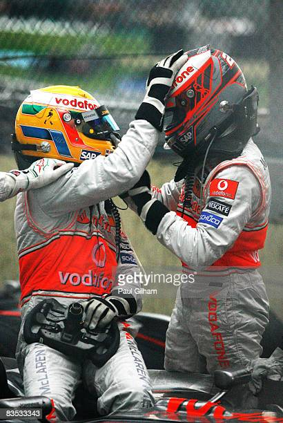New Formula One World Champion Lewis Hamilton of Great Britain and McLaren Mercedes celebrates with team mate Heikki Kovalainen of Finland and...