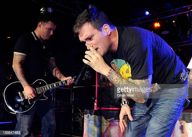 New Found Glory guitarist Chad Gilbert and singer Jordan Pundik perform during the Pop Punk's Not Dead tour at the Hard Rock Cafe on the Strip in...