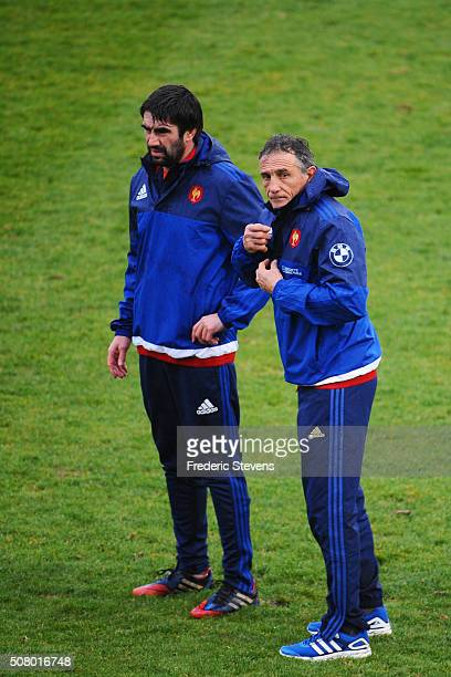 New France head coach Guy Noves speaks with France assistant coach Yannick Bru during a training session National Center of french rugby in...