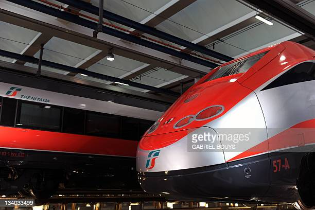 A new Freccia Rossa highspeed train is displayed at the Freccia Rossa workshop in Naples on November 24 2011 The new Freccia Rossa with four...