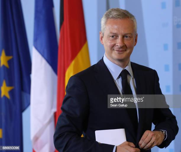 New French Finance Minister Bruno Le Maire departs after speaking to the media with German Finance Minister Wolfgang Schaeuble following talks on May...