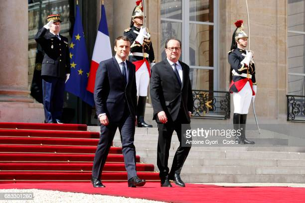 New French President elect Emmanuel Macron escorts French Former President Francois Hollande to his car after attending a formal ceremony as part of...