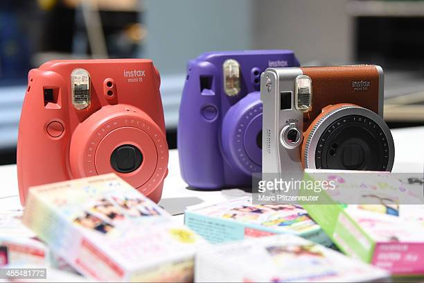 New Fujifilm Instax cameras are displayed at the Photokina 2014 trade fair on September 15 2014 in Cologne Germany Photokina is the world's largest...