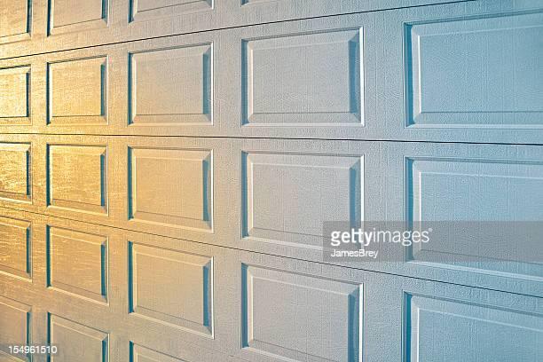 New Garage Door Surface Reflecting Sunrise