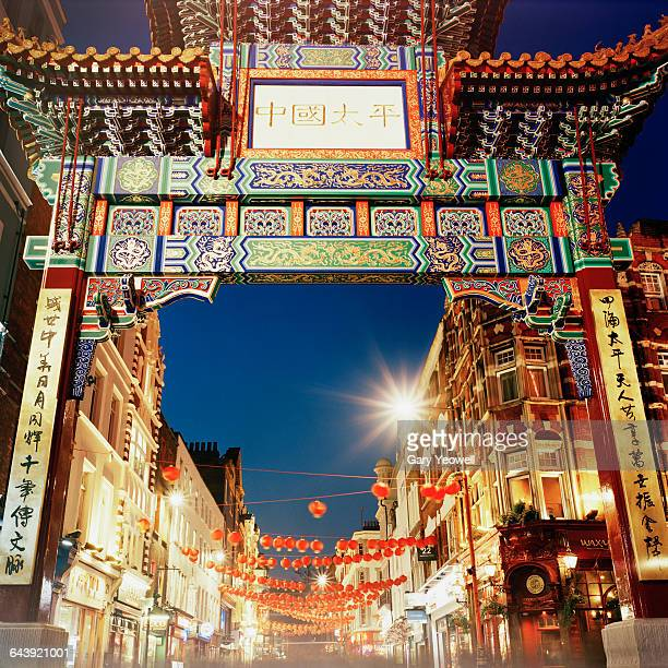 new gate in entrance to london's chinatown - chinatown stock photos and pictures