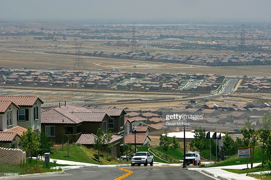 A new gated community housing project overlooks a rural landscape that is being rapidly converted into a vast suburb as a construction boom continues in San Bernardino County during World Population Day on July 11, 2007 near Rancho Cucamonga, California. San Bernardino County and neighboring Riverside County in Southern California are among the fastest growing areas in the state and are expected to help drive the total state population to almost 60 million in 2050. In the 20th century, the world's population exploded from 220 million to 2.8 billion and that rate will increase exponentially. By 2008, 3.3 billion people, more than half the world's population, are expected to be living in urban areas.