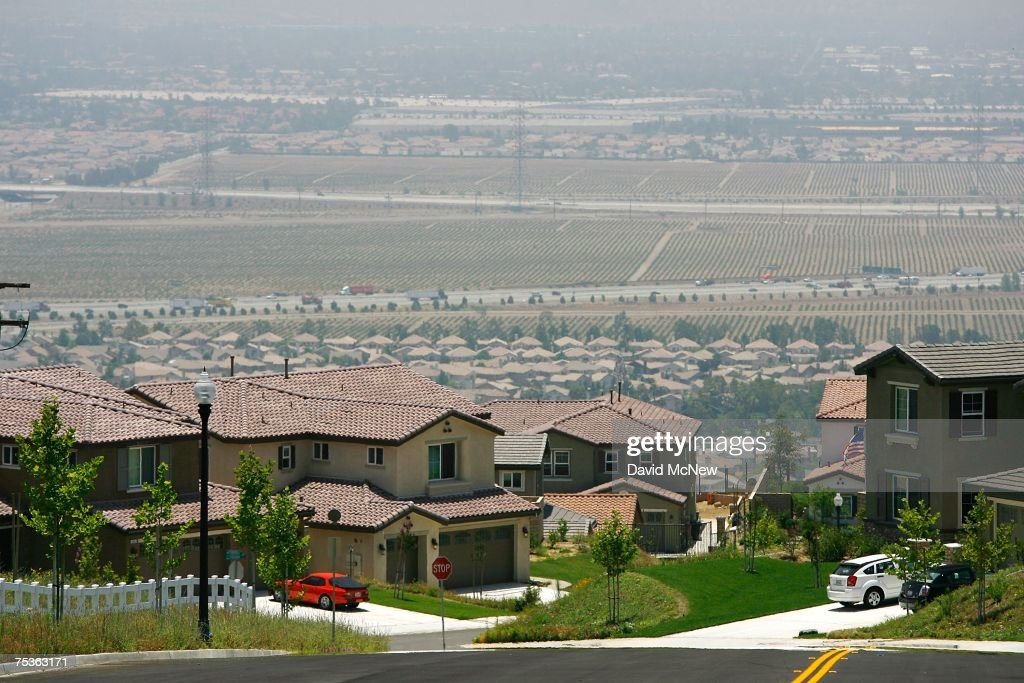 A new gated community housing project overlooks farms that are being rapidly converted into a vast suburb as a construction boom continues in San Bernardino County during World Population Day on July 11, 2007 near Rancho Cucamonga, California. San Bernardino County and neighboring Riverside County in Southern California are among the fastest growing areas in the state and are expected to help drive the total state population to almost 60 million in 2050. In the 20th century, the world's population exploded from 220 million to 2.8 billion and that rate will increase exponentially. By 2008, 3.3 billion people, more than half the world's population, are expected to be living in urban areas.
