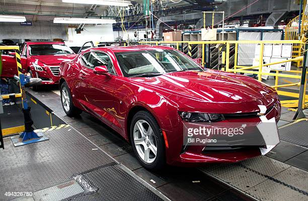 A new General Motors 2016 Chevrolet Camaro rolls off the production line at GM's Lansing Grand River Assembly Plant October 26 2015 in Lansing...