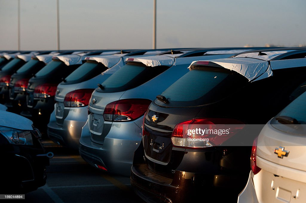 New General Motors Co. Chevrolet automobiles stand in a parking lot ahead of shipping at Barcelona port in Barcelona, Spain, on Thursday, Jan. 10, 2013. Spanish exports grew the least in five months in September as the euro area relapsed into a recession and the region's fourth-largest economy continued to contract. Photographer: David Ramos/Bloomberg via Getty Images