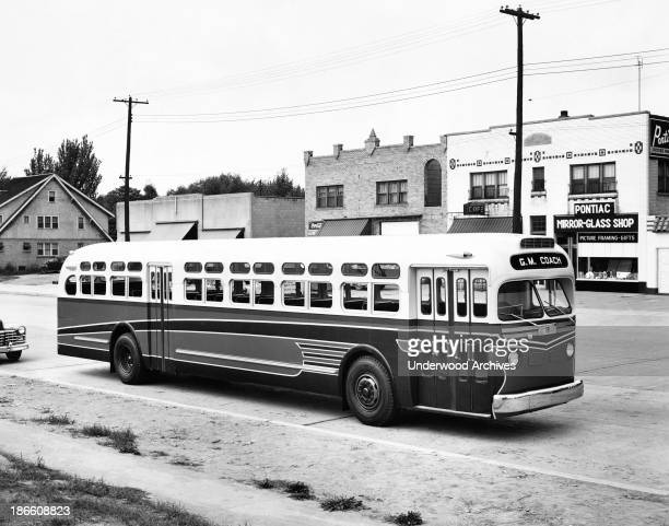 A new General Motors Coach parked in a small town late 1940s
