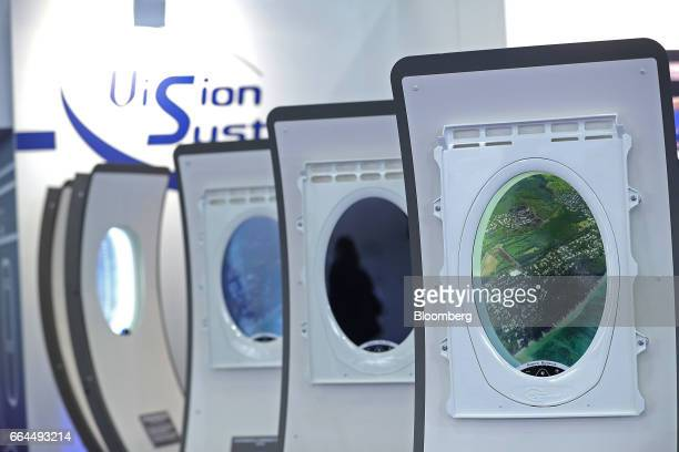 New generation of electronically dimmable airline windows manufactured by Vision Systems stand on display at the Aircraft Interiors Expo in Hamburg,...