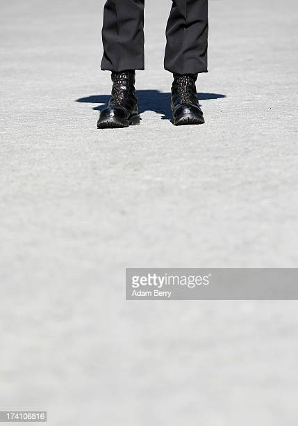 A new German Bundeswehr soldier waits for the start of a swearingin ceremony for new recruits of the Bundeswehr the armed forces of the Federal...