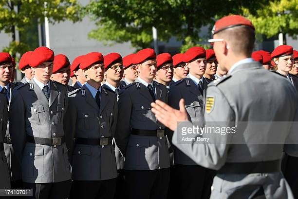 New German Bundeswehr soldiers are briefed prior to a swearing-in ceremony for new recruits of the Bundeswehr, the armed forces of the Federal...