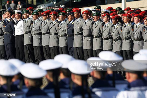New German Bundeswehr soldiers attend a swearingin ceremony for new recruits of the Bundeswehr the armed forces of the Federal Republic of Germany in...