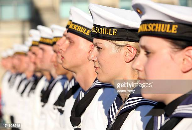 New German Bundeswehr soldiers stand at attention at the end of a swearingin ceremony for new recruits of the Bundeswehr the armed forces of the...