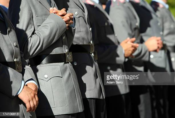 New German Bundeswehr soldiers wait for the start of a swearingin ceremony for new recruits of the Bundeswehr the armed forces of the Federal...
