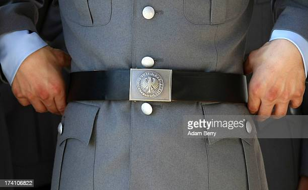 A new German Bundeswehr soldiers waits for the start of a swearingin ceremony for new recruits of the Bundeswehr the armed forces of the Federal...