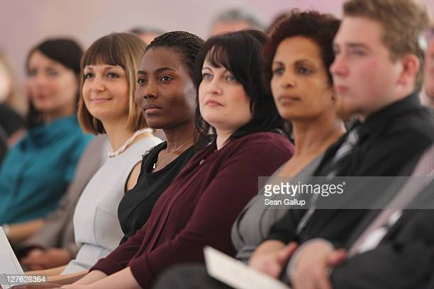 New German citizens attend a ceremony at Bellevue presidential palace where German President Christian Wulff presented them their citizenship...