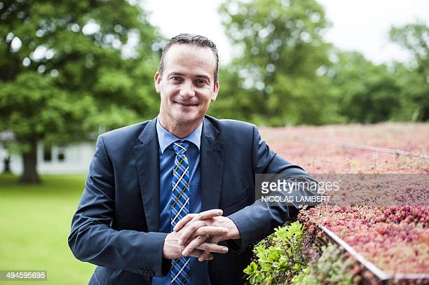 New German Community Minister President Oliver Paasch poses after a press conference to present the new government of the German Community in Eupen...