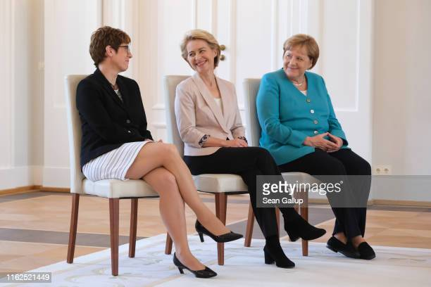 New German Defense Minister Annegret KrampKarrenbauer German Chancellor Angela Merkel and outgoing Defense Minister Ursula von der Leyen attend...