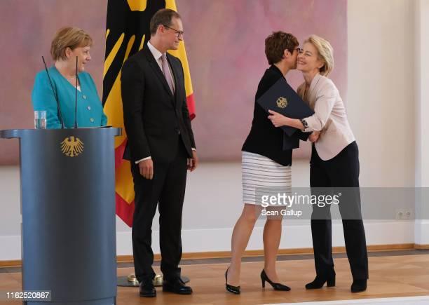 New German Defense Minister Annegret Kramp-Karrenbauer receives an embrace from outgoing Defense Minister Ursula von der Leyen at the appointment...