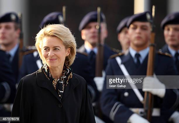 New German Defense Minister Ursula von der Leyen reviews soldiers of the Bundeswehr shortly after she took office at the Defense Ministry on the day...
