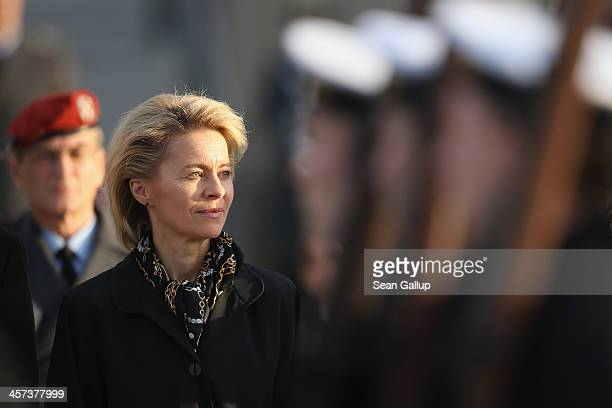 New German Defense Minister Ursula von der Leyen watches as Bundeswehr soldiers parade past shortly after she took office at the Defense Ministry on...