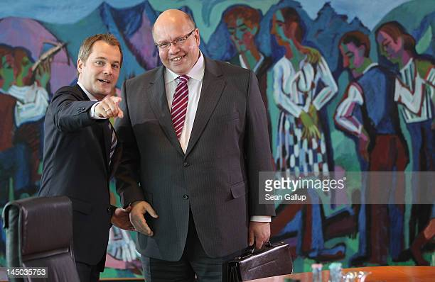New German Environment Minister Peter Altmaier and Health Minister Daniel Bahr arrive for his first German government weekly cabinet meeting since...