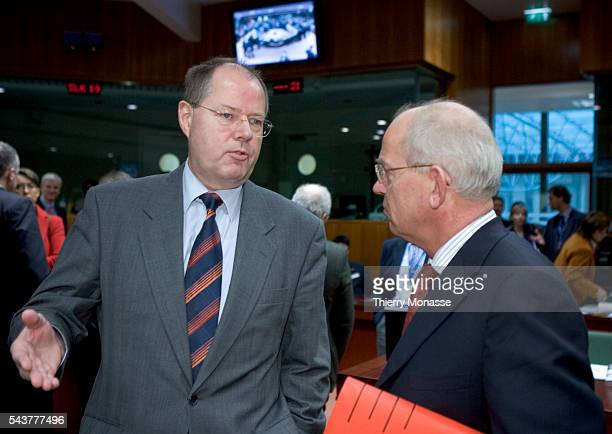 New German Finance Minister Peer Steinbrueck talking with Netherlands counterpart Gerrit Zalm prior to the start of the Econnomy and Finance Council...