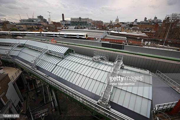 A new glass and steel vaulted roof covers Borough Market on February 7 2013 in London England Borough Market London's oldest since 1756 has recently...