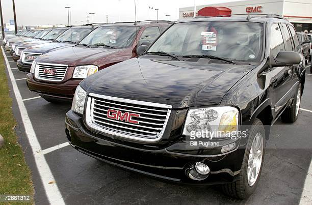 A new GMC SUV sits among other vehicles at a General Motors dealership November 28 2006 in Troy Michigan The Commerce Department issued a report...